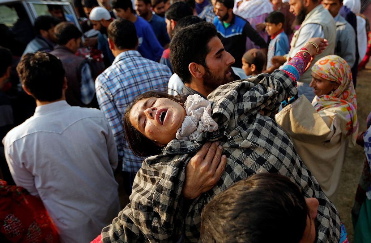 A relative of Yasmeena mourns during her funeral in Khonmoh, south of Srinagar.