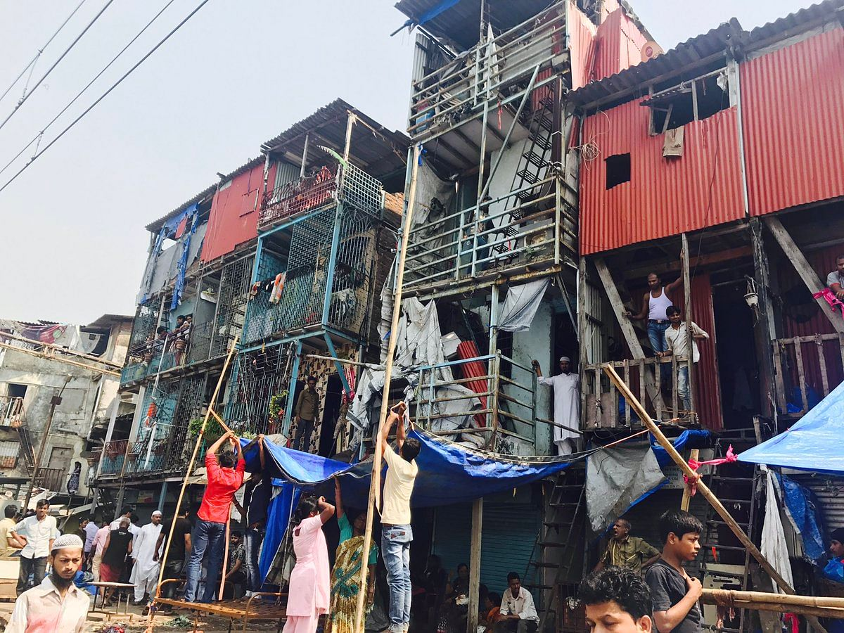 People try to rebuild and salvage whatever they can out of the ruins of the fire in Bandra slums. (Representational Image)