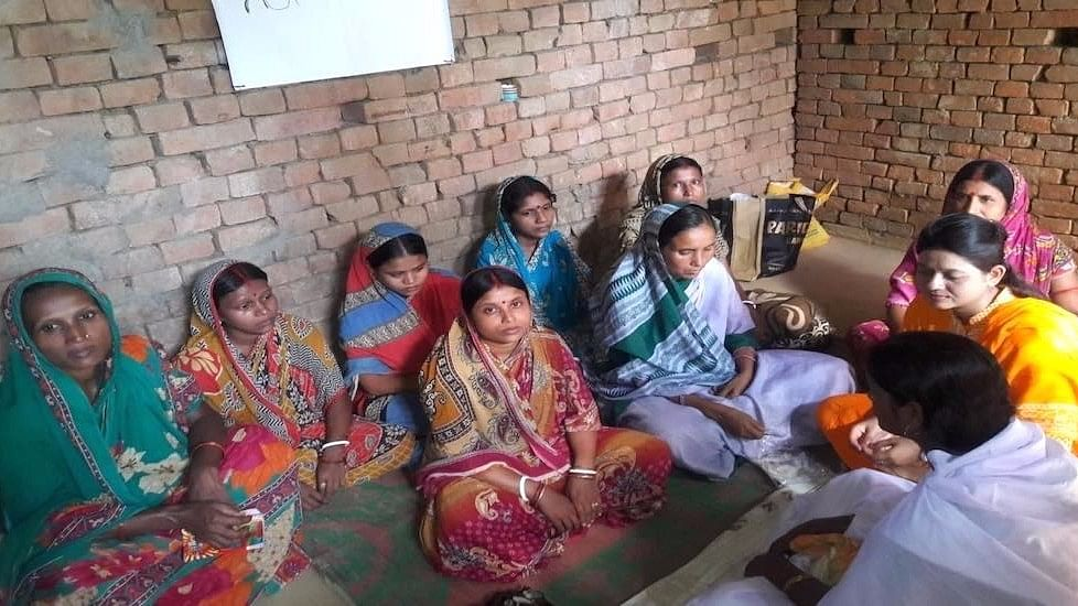 Women of the Ilami panchayat learn about health, hygiene and pregnancy care at the night school.