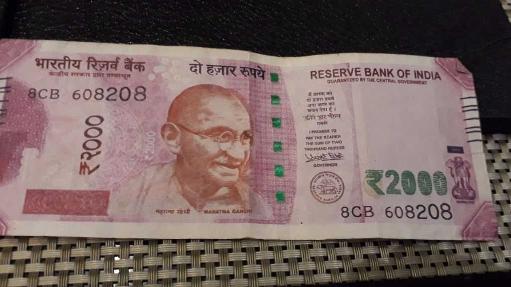 A fake Rs 2,000 note that was rejected as it didn't have RBI inscribed along the silver vertical thread.