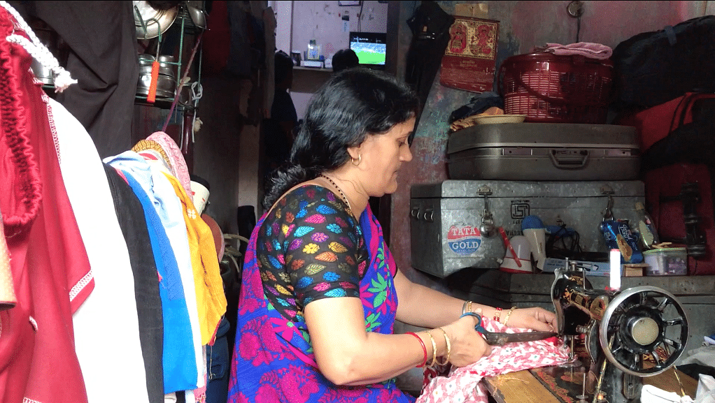 Jitendra Singh's mother Hema Devi sustains the family with her tailoring.