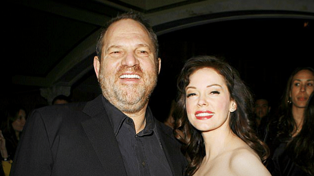 Harvey Weinstein with Rose McGowan at an event.