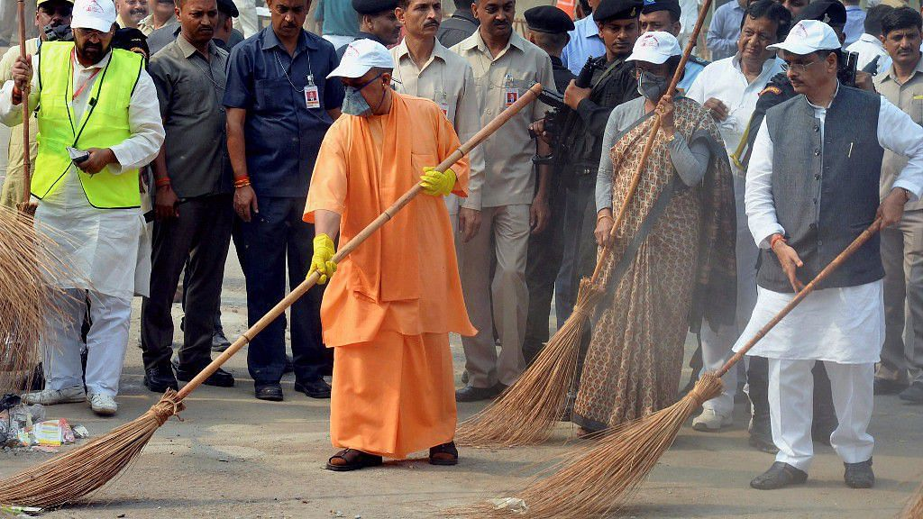 Chief Minister Yogi Adityanath wields a broom as he takes part in a cleanliness drive at the western gate of the Taj Mahal in Agra.