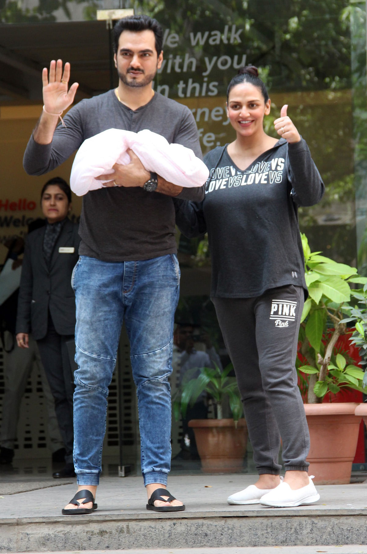 Esha Deol leaves the hospital with her newborn daughter and husband Bharat Takhtani.