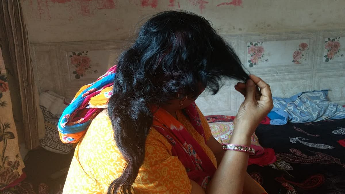 A Delhi resident shows where her hair was chopped off when the choti cutting scare took the capital by storm. Image used for representation.