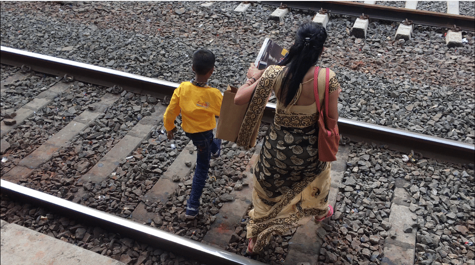 Commuters trespass railway tracks at Jogeshwari station.