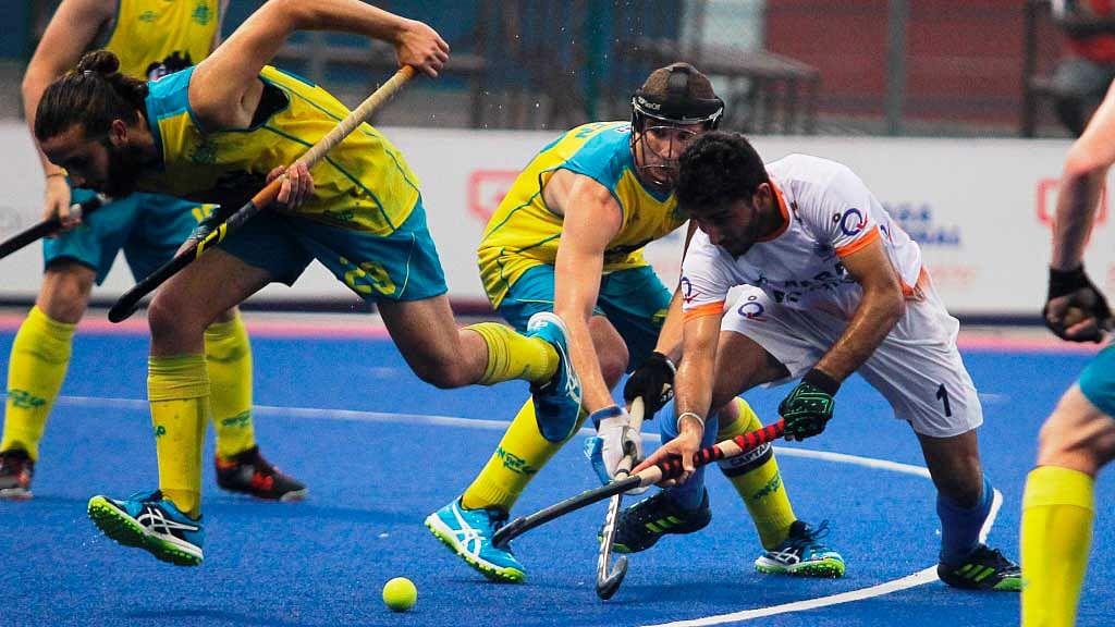 Junior men's teams of Australia and India in action.