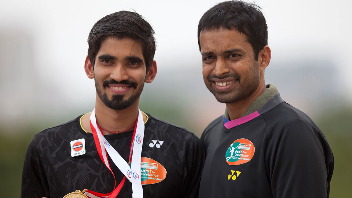Indian Badminton player Srikanth Kidambi along with his coach Pullela  Gopichand pose for photographs after returning from his Indonesian Open and Australian Open Super Series titles.