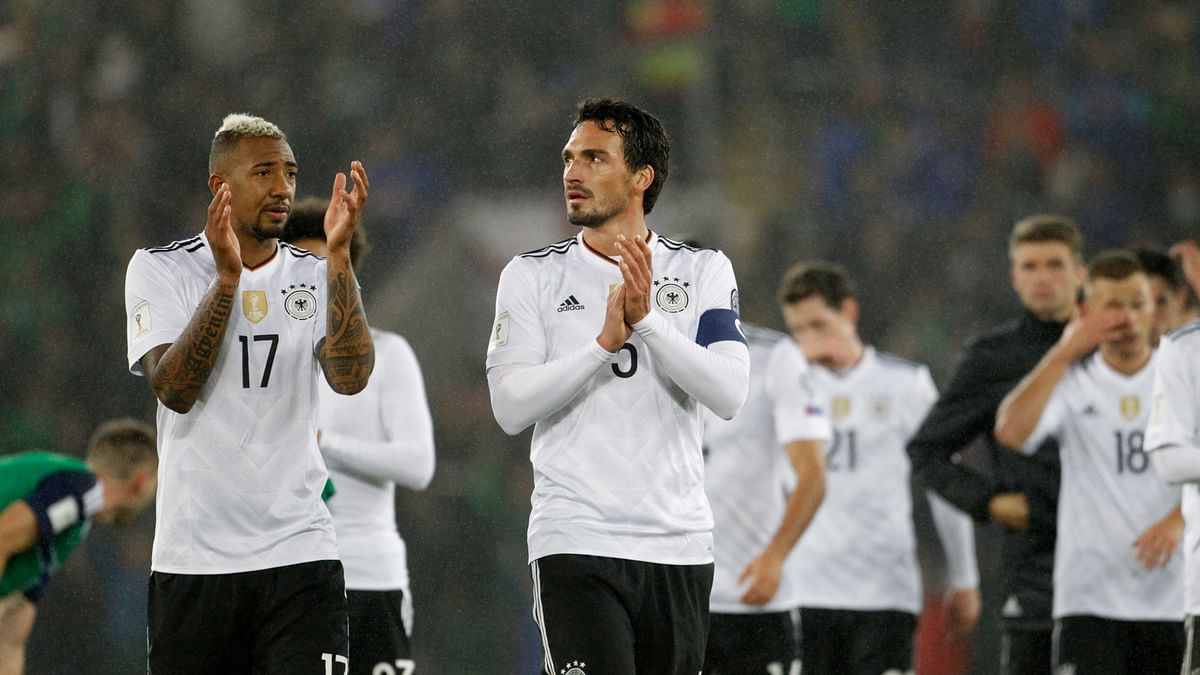 Germany's, from left, Jerome Boateng and Mats Hummels applaud their supporters after the World Cup Group C qualifying soccer match between Northern Ireland and Germany at Windsor Park in Belfast, Northern Ireland, Thursday, Oct. 5, 2017.