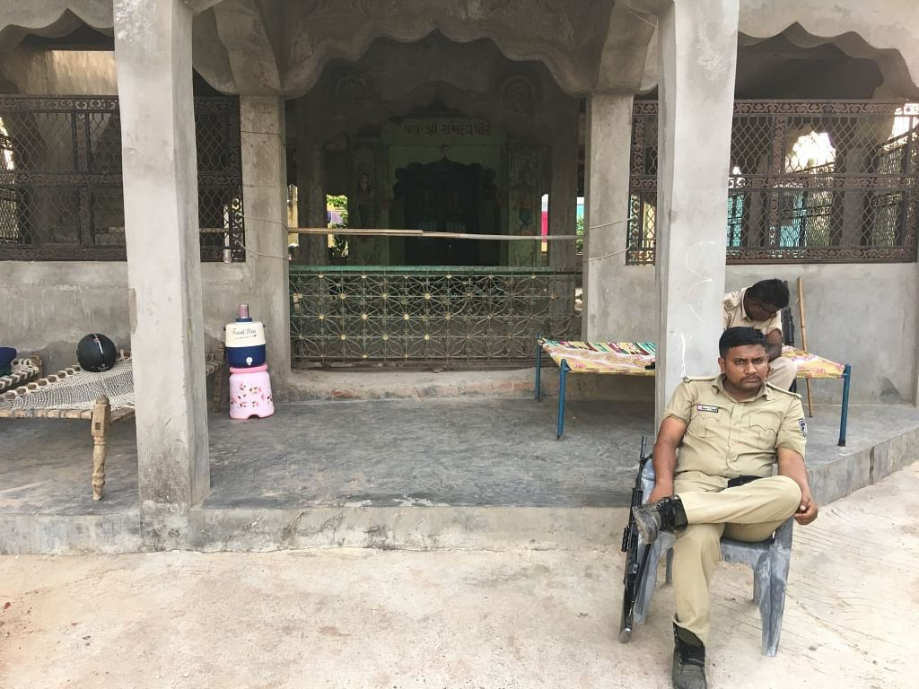 Officials of the State Reserve Police force are sitting guard outside Digant Maheriya's house in Limbodara.