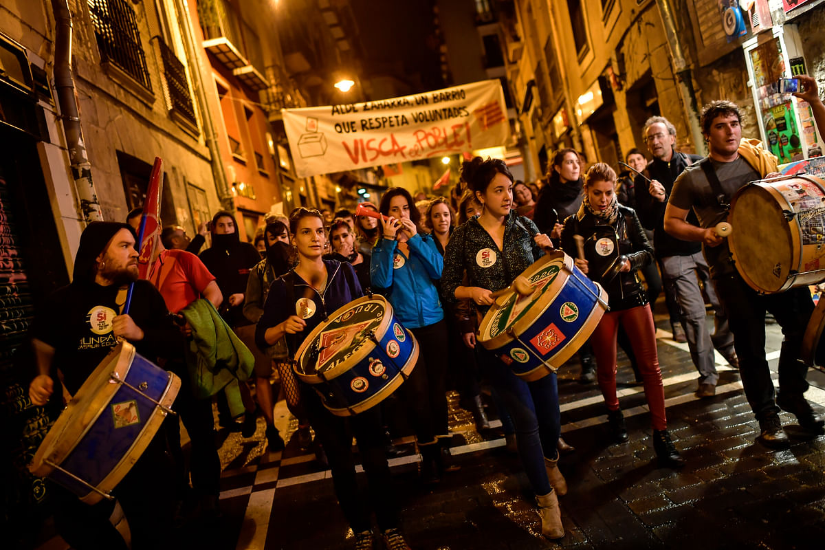 Pro independence supporters play their drums with banner reading, ''Long life working class'', while they walk through the old city in support of the Catalonia's secession referendum.