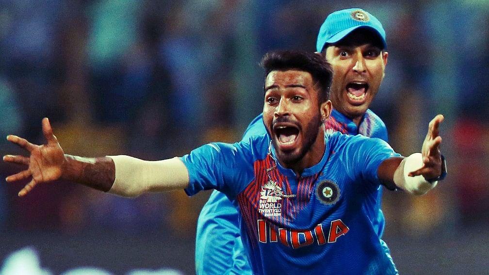 Hardik Pandya celebrates a wicket with Yuvraj Singh during the World T20.