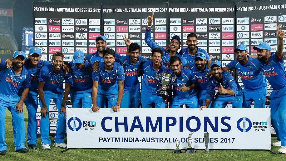 The Indian team pose with the ODI series trophy.