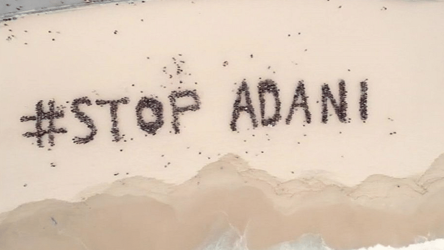 Australians on Bondi beach protest against the proposed Carmichael mine to be operated by the Adani group.