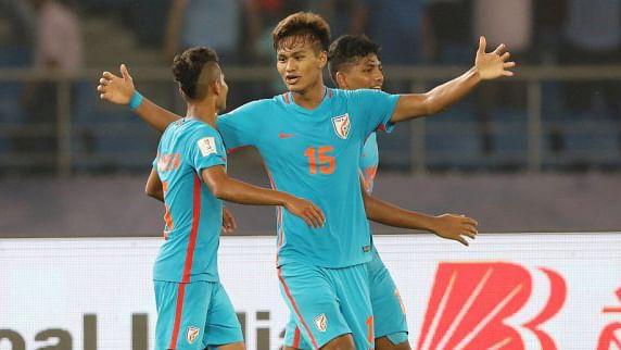 Jeakson Singh celebrates his goal with teammates.