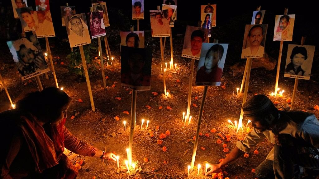 People light candles during a prayer ceremony in Ahmedabad for the victims of the Godhra train. Photo used for representational purpose.