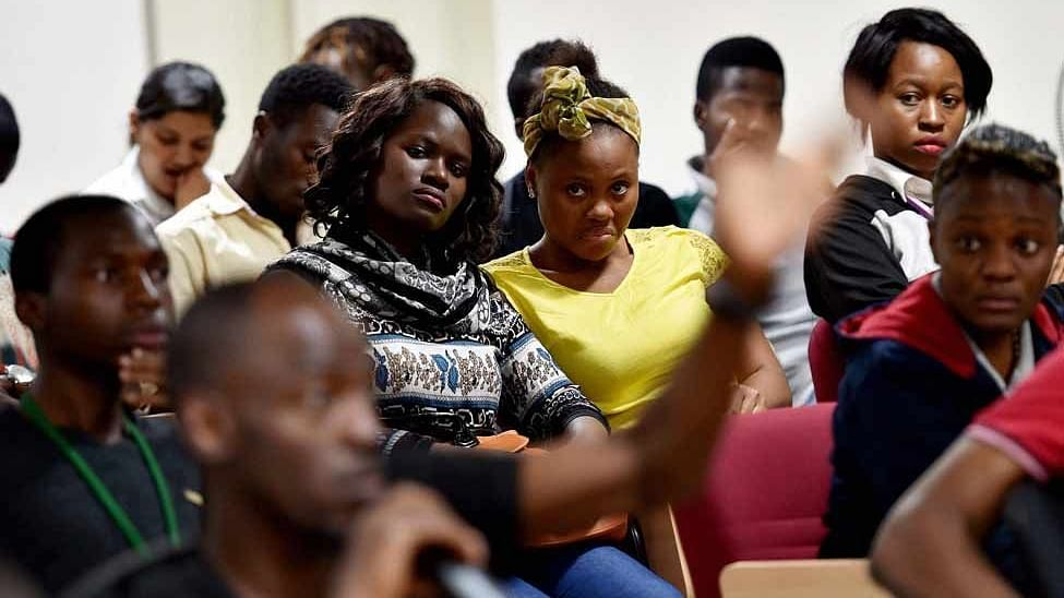 African students in Bangalore at a meeting with the police in Bengaluru. (Photo: PTI)