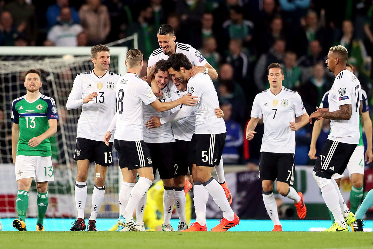 Germany's SebastianRudy, fourth from left, celebrates scoring his side's first goal of the game with his team-mates during the World Cup Group C qualifying soccer match between Germany and Northern Ireland at Windsor Park, Belfast, Northern Ireland.&nbsp;<a></a>