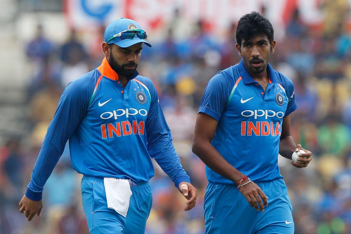 Virat Kohli speaks to Jasprit Bumrah during the fifth ODI.
