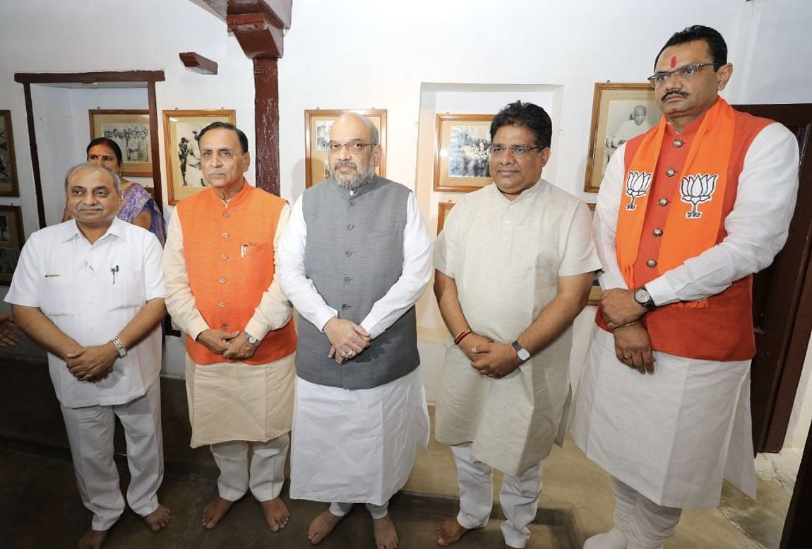 BJP President Amit Shah with party leaders in Gujarat.