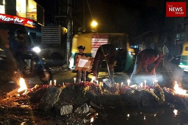Residents performing last rites of a pothole