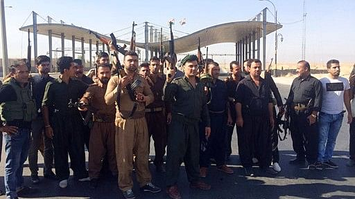 Kurdish security forces and volunteers are deployed in the southern entrance of Kirkuk.