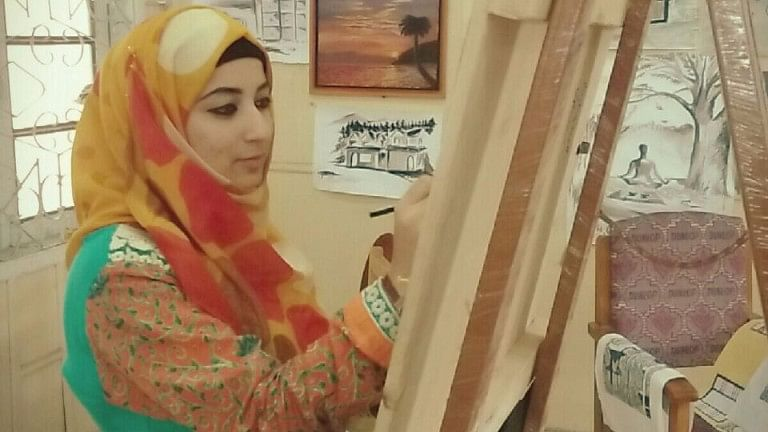 Artist Mehnaz Gani paints at the Department of Music and Fine Arts, University of Kashmir.