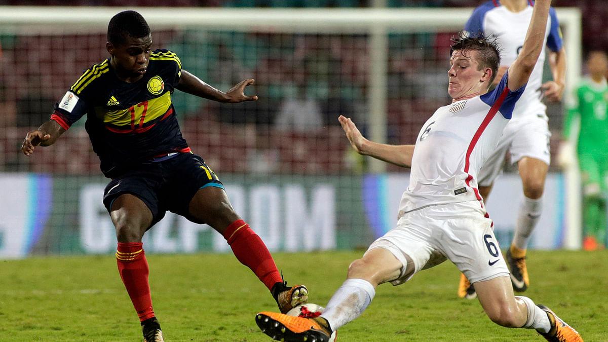 USA's Blaine Ferri duels for the ball against Colombia's Deiber Caicedo.