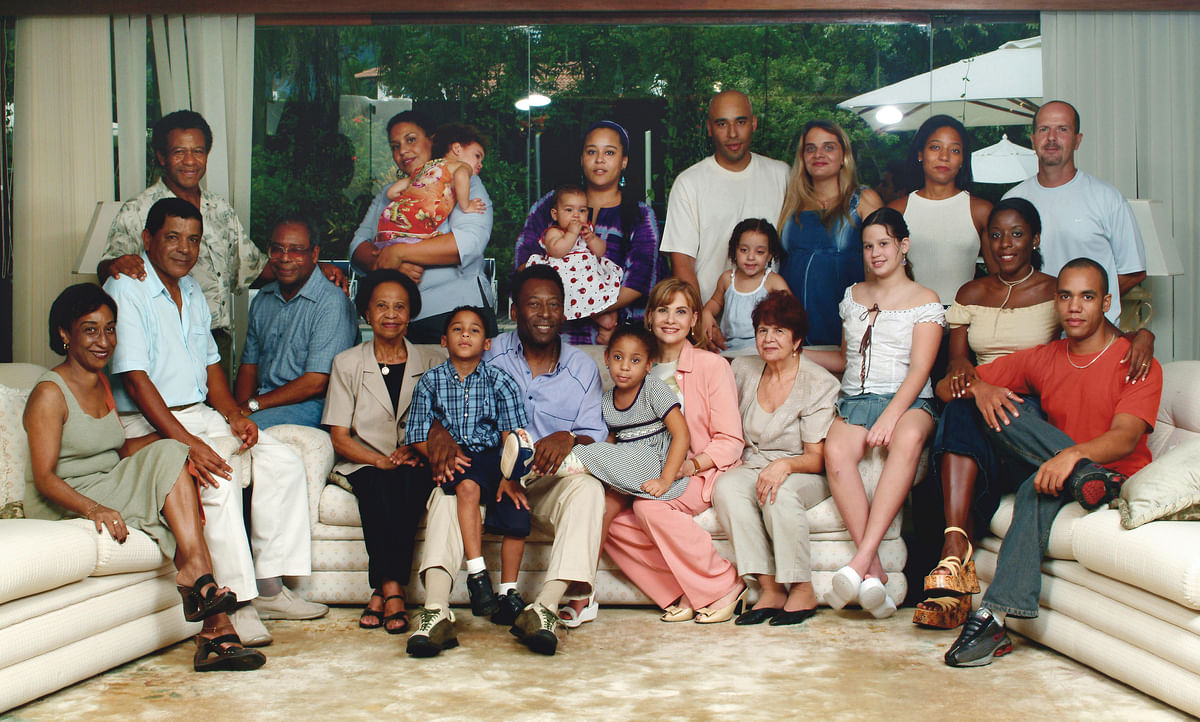 Brazilian football legend Pele sits for a portrait with his extended family, in his summer home in the Atlantic coastal city of Guaruja, in Sao Paulo state, 14 February 2003.