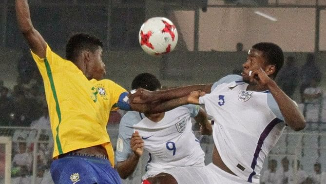 Brazil's Vitao duels for the ball against England's Rhian Brewster.