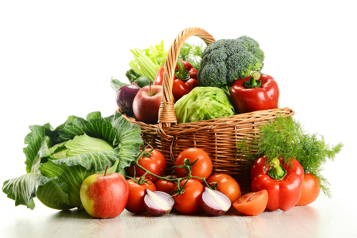 A lot of fruits and veggies can be kept in a basket and placed on kitchen cabinets.