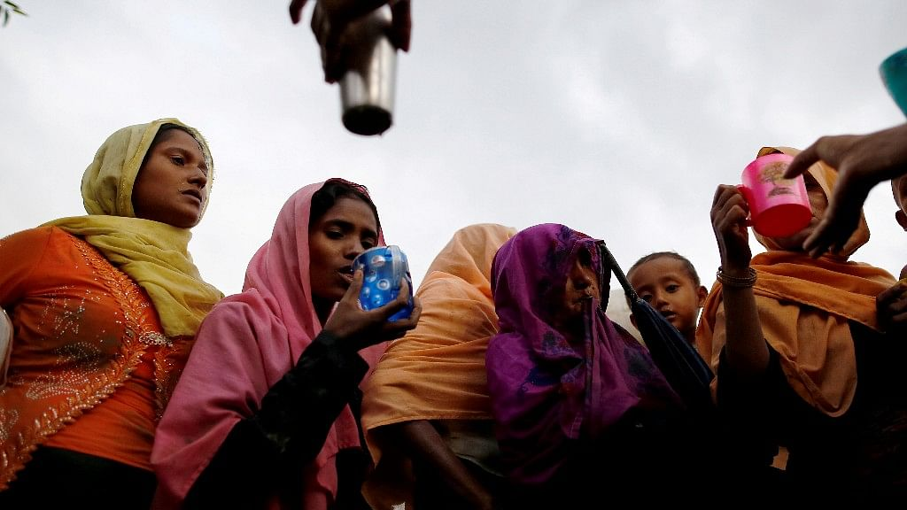 Rohingya refugees fleeing to Bangladesh.