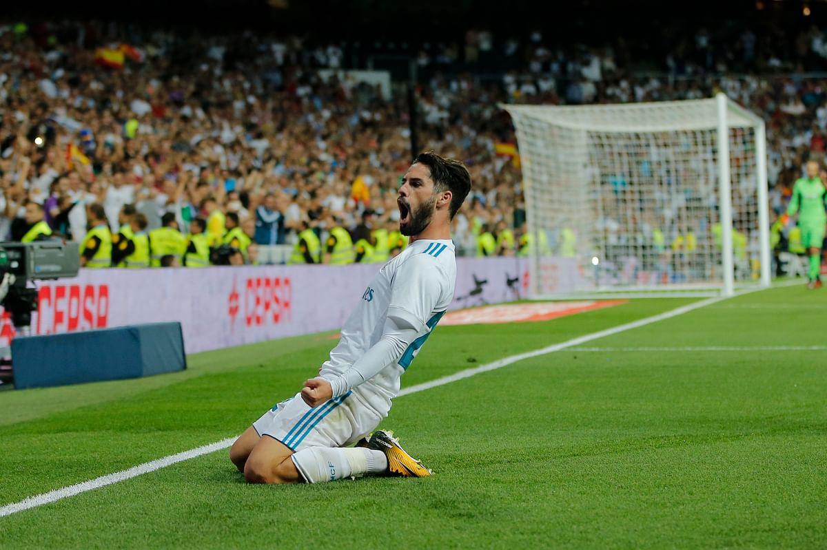 Real Madrid's Isco celebrates after scoring his second goal during a Spanish La Liga soccer match between Real Madrid and Espanyol at the Santiago Bernabeu stadium in Madrid, Spain, Sunday, Oct. 1, 2017.