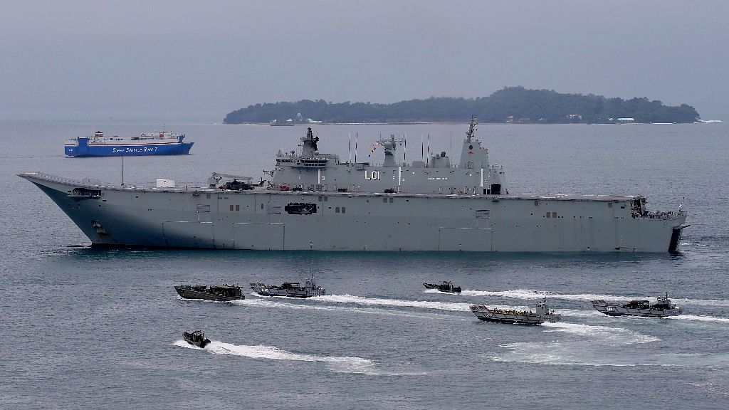 The Royal Australian Navy HMAS Adelaide cruises alongside landing crafts with Philippine Marines and Australian troops as they conduct a joint Humanitarian Aid and Disaster Relief (HADR) exercise off Subic Bay in northwestern Philippines.