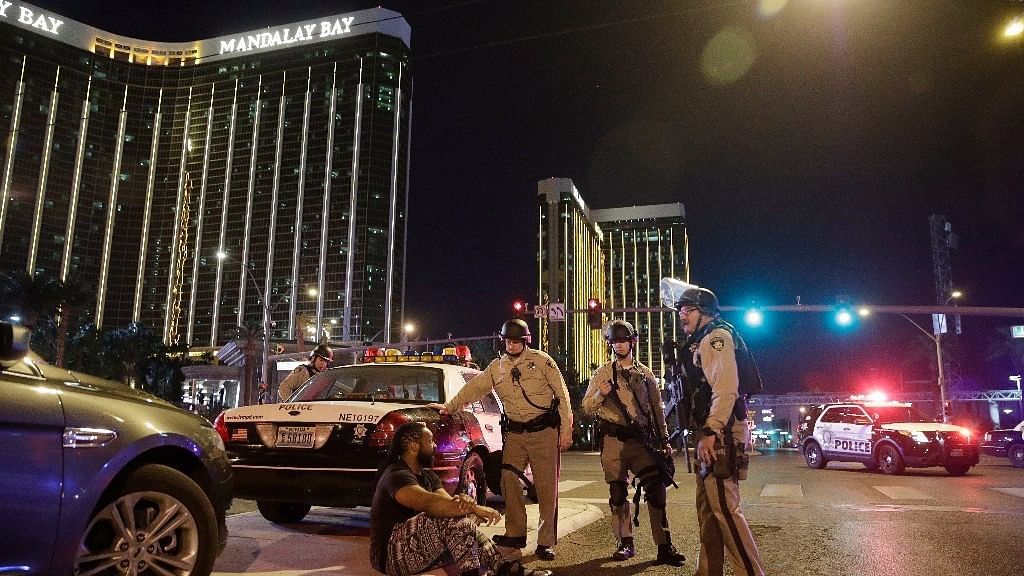 Police officers stand at the scene of the shooting near the Mandalay Bay resort and casino on the Las Vegas Strip.