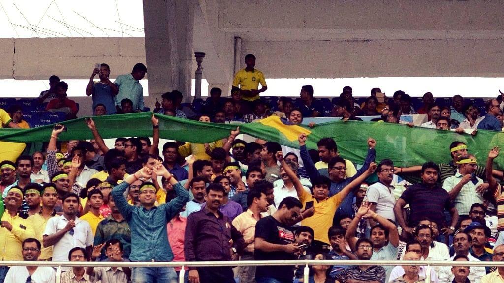 Kolkata: Football fans cheer during the FIFA U17 World Cup 2017 Semi Final match between Brazil and England at Salt Lake stadium  in Kolkata, on Oct 25, 2017.