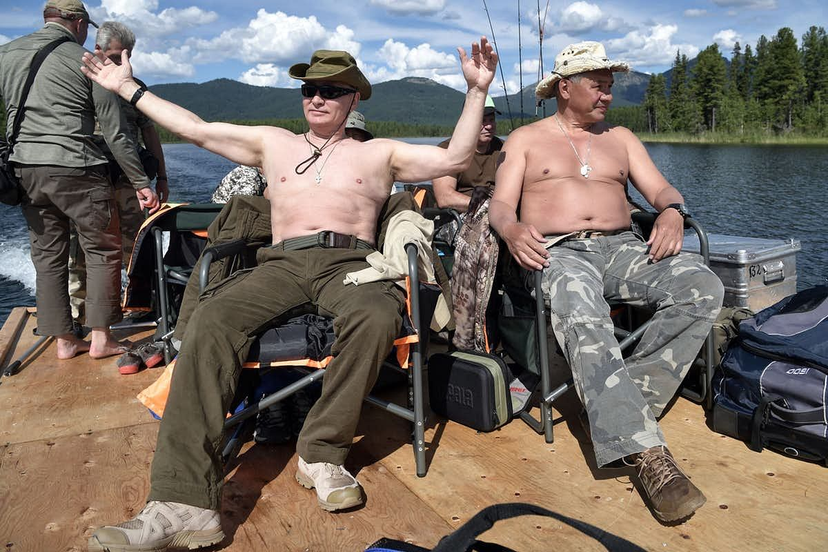 A rare photo of Vladimir Putin (centre) on vacation!