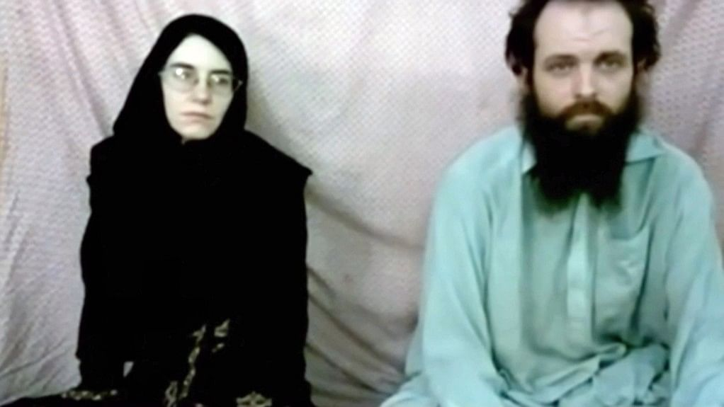 A still image made from a 2013 video released by the Coleman family shows Caitlan Coleman and her husband, Canadian Joshua Boyle in a militant video given to the family.