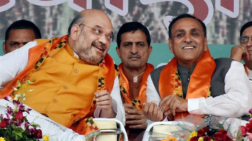 <p>Gujarat Chief Minister Vijay Rupani with BJP President Amit Shah at a rally in Gujarat.</p>