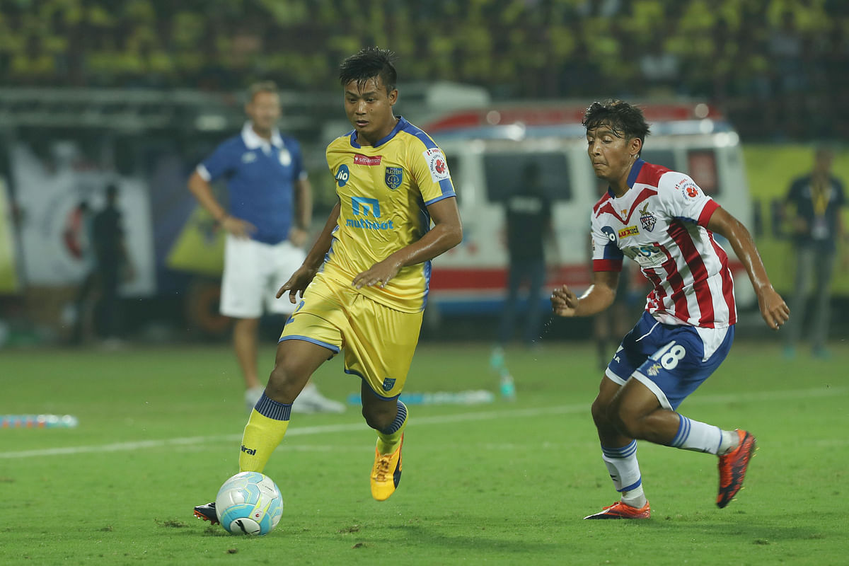 Kerala Blasters' Milan Singh moves the ball forward.