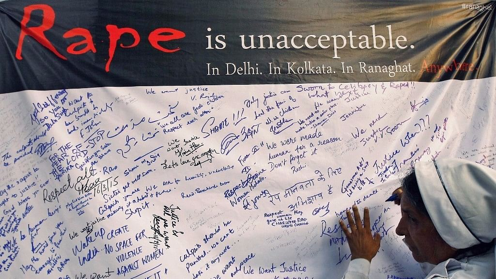 Signatures for anti-rape on a banner.