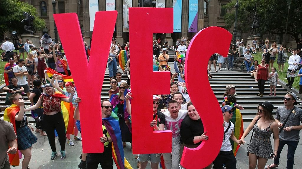 People celebrate after the announcement of the same-sex marriage postal survey result in front of the State Library of Victoria in Melbourne, Australia, on 15 November 2017.