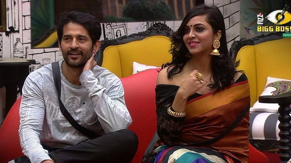Hiten Tejwani and Arshi Khan during a task.