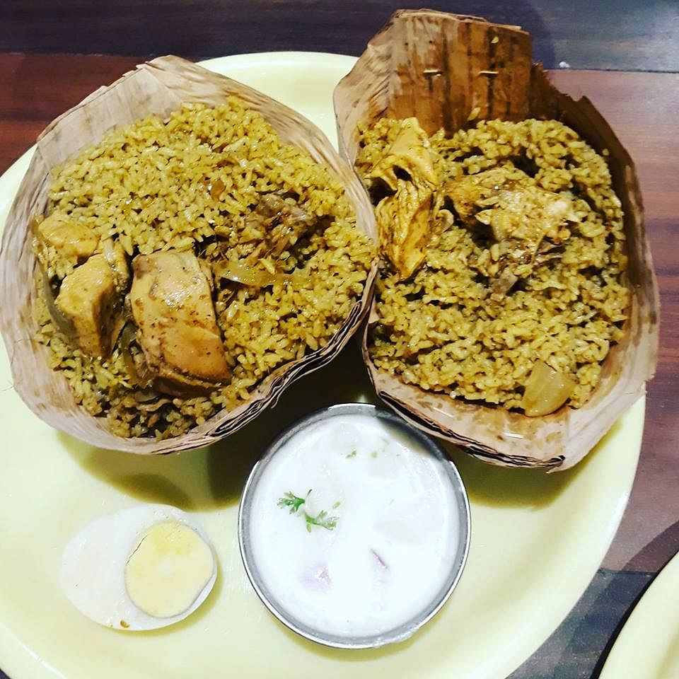 Donne Biryani served in cups made of palm leaves.