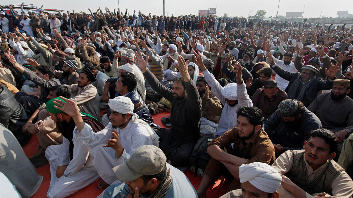 Protesters shout slogans during a sit-in protest near  Islamabad on Monday, 20 November.