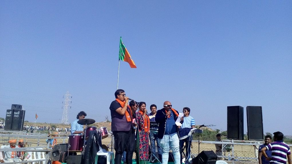Popular Gujarati Singer Arvind Vegada performs for the crowd before Modi's rally starts in Jasdan, on Monday.