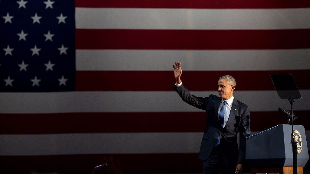US President Barack Obama waves to the audience before delivering his farewell address in Chicago.