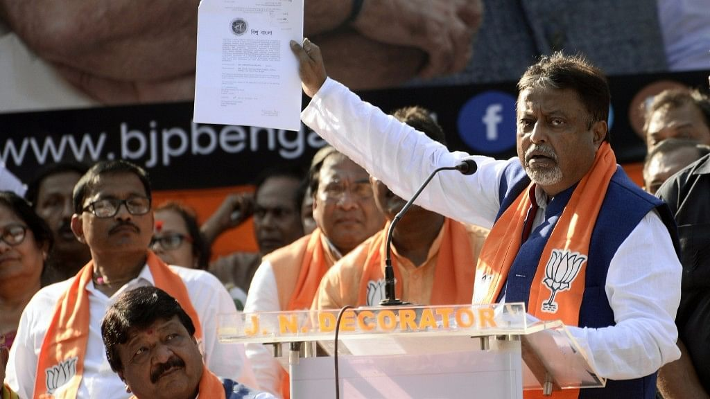 leader Mukul Roy addresses during a party's protest rally against West Bengal government in Kolk