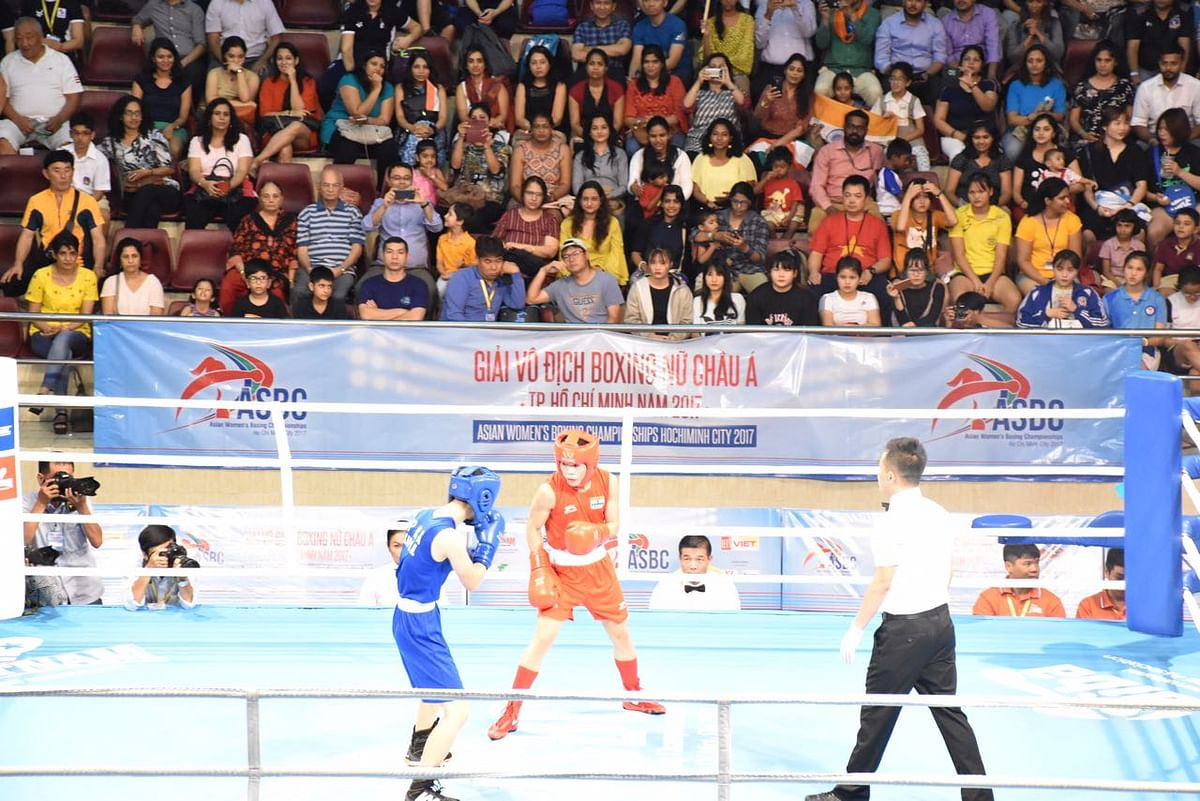 Mary Kom takes on North Korea's Hyang Mi Kim in the Asian Boxing Championships final.