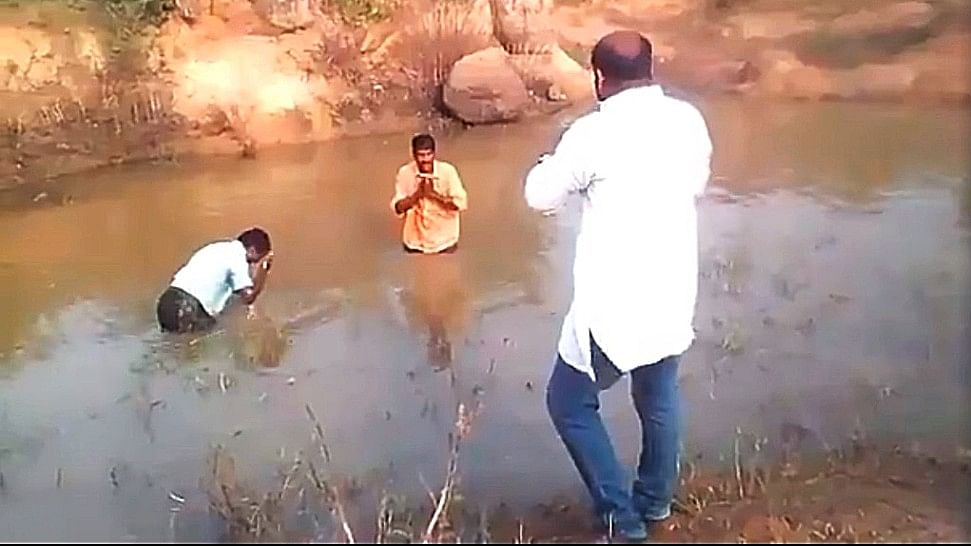 The video shows the alleged BJP leader forcing the men to dunk themselves in muddy water.
